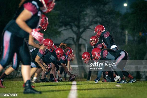 female american football team training - line of scrimmage stock pictures, royalty-free photos & images