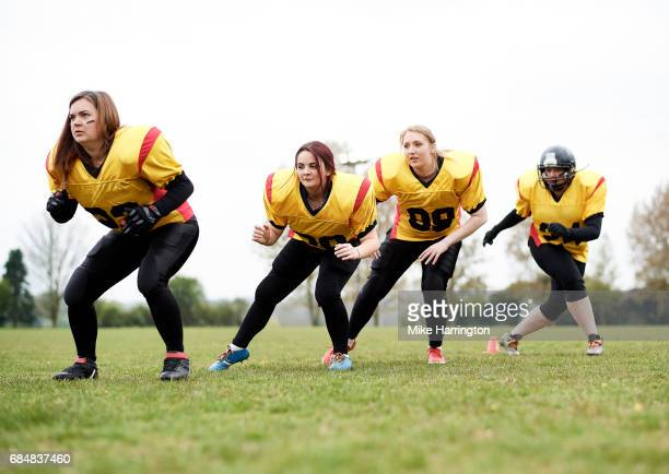 female american football team warming up - safety american football player stock pictures, royalty-free photos & images