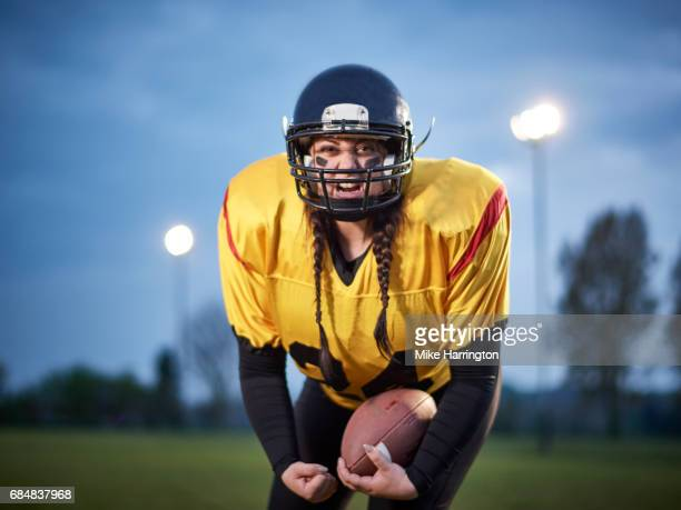 female american footballer - safety american football player stock pictures, royalty-free photos & images