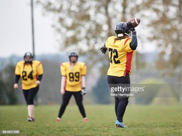 female american footballer throwing ball - safety american football player stock pictures, royalty-free photos & images