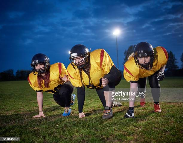 female american footballers practicing in evening light - safety american football player stock pictures, royalty-free photos & images