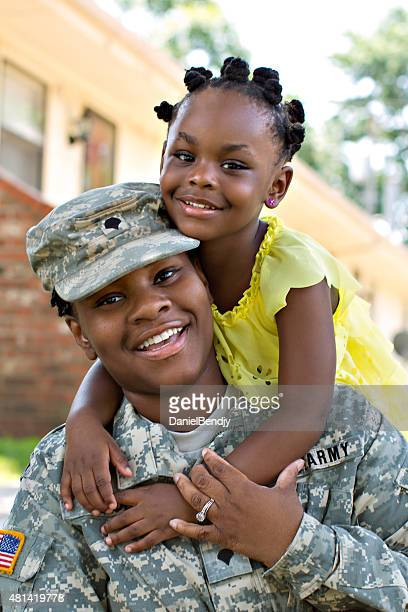 Female American Soldier and Daughter