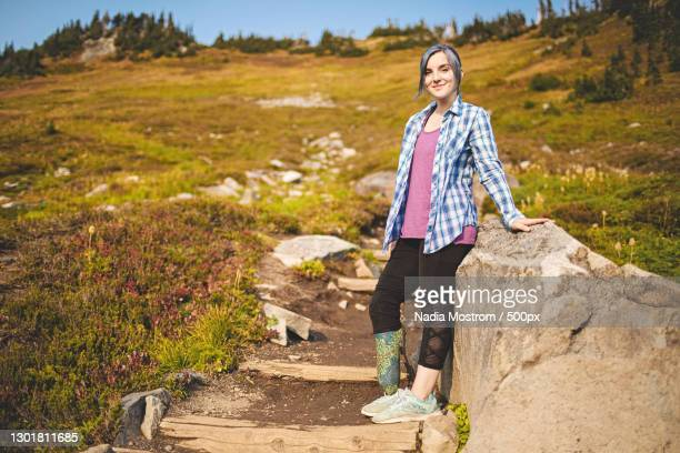 female amputee hiking and exploring nature,mount rainier,washington,united states,usa - leaning disability stock pictures, royalty-free photos & images