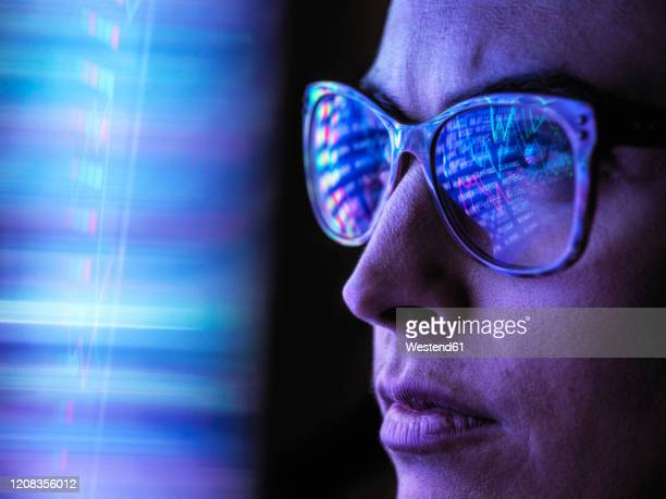 female analyst viewing financial market data on a screen - stock trader stock pictures, royalty-free photos & images