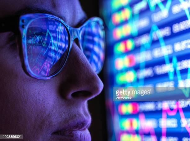 female analyst viewing financial market data on a screen - performance stock pictures, royalty-free photos & images