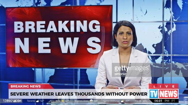 female anchor presenting breaking news about severe weather causing power outage - journalist stock pictures, royalty-free photos & images