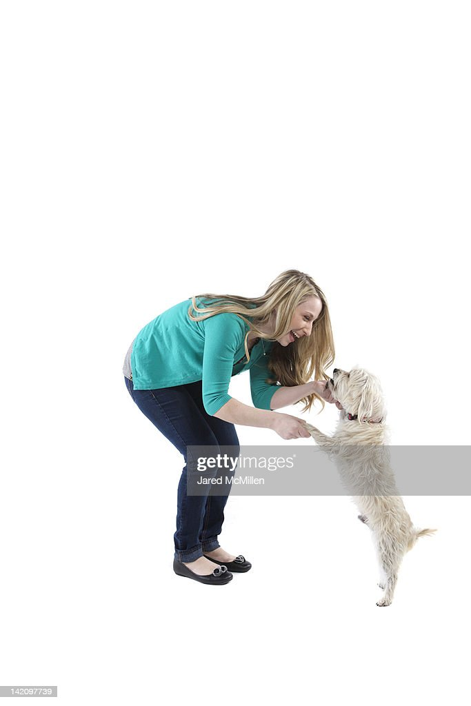 Female and her dog photographed in the studio. : Stock Photo