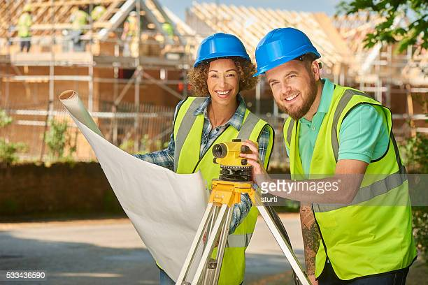 female and male building surveyors