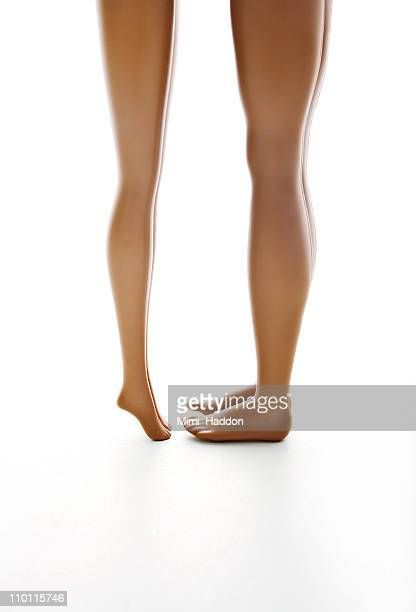Female and Male Doll Legs Facing One Another