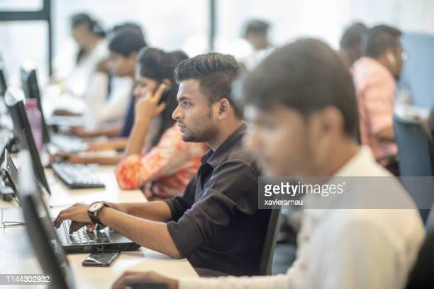 female and male entrepreneurs working at office - india stock pictures, royalty-free photos & images