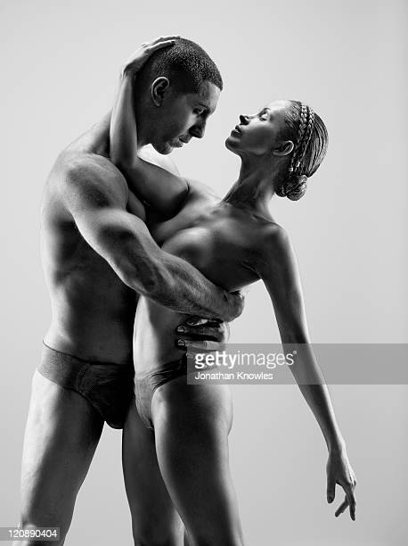 female and male in paint posing - frau in slip stock-fotos und bilder
