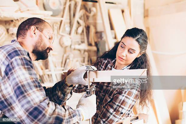 Female and male manual workers manufacturing together