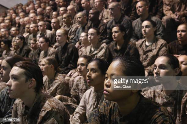 Female and male Marine recruits listen to instructions as they prepare for a swimming test during boot camp February 25 2013 at MCRD Parris Island...