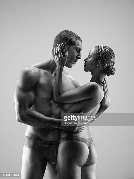 female and male painted  posing - frau in slip stock-fotos und bilder