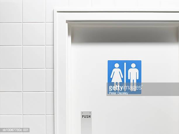 female and male sign on toilet door, close-up - public toilet stock pictures, royalty-free photos & images