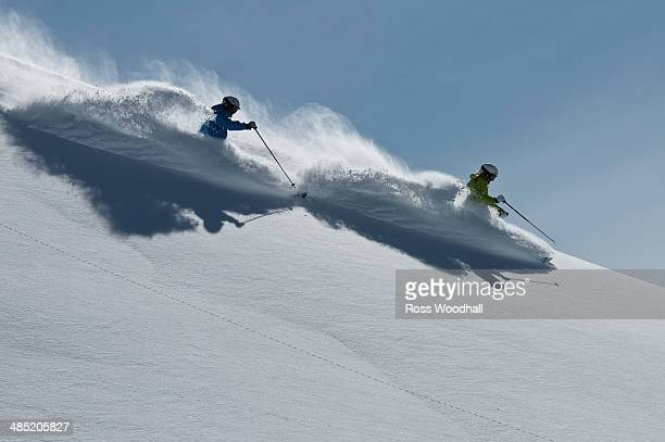Female and male skiers racing downhill, Obergurgl, Austria