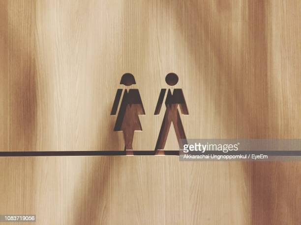 female and male symbol on door - female likeness stock pictures, royalty-free photos & images