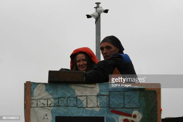 A female Anti Frack Protestor shows the photographer the steel box within which her and her partner have locked themselves on to a wooden tower to...
