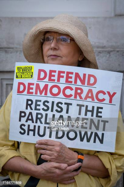 A female antiBrexit campaigner outside the Cabinet Office on Whitehall on the 29th August 2019 in London in the United Kingdom A group gather outside...