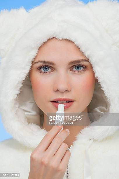 Female applying lip balm on her lips