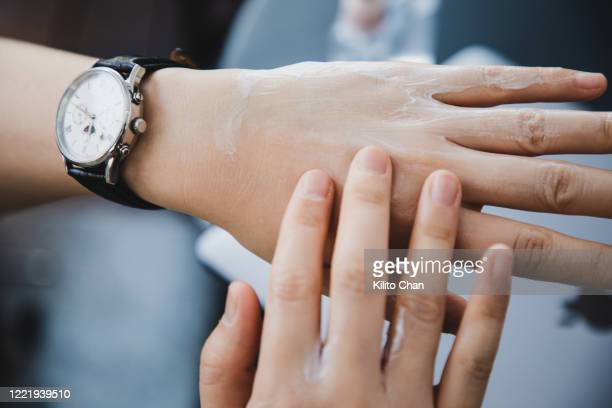 female applying lotion to the hand - dry skin stock pictures, royalty-free photos & images