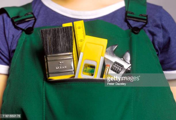 female apprentice doing house repairs - renovation stock pictures, royalty-free photos & images