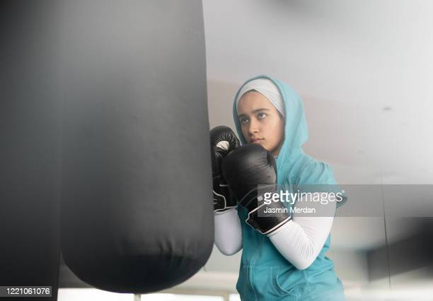 female arabic kickboxer fighter training - boxing stock pictures, royalty-free photos & images