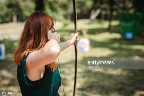 female archer in the fieald - archery stock pictures, royalty-free photos & images