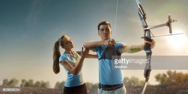 Female archer teaches archery