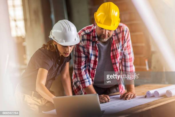 Female architect and foreman