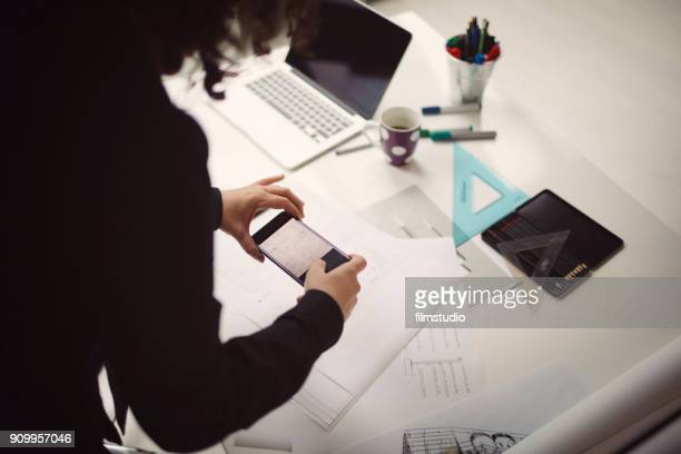female architect at work - photo messaging stock photos and pictures
