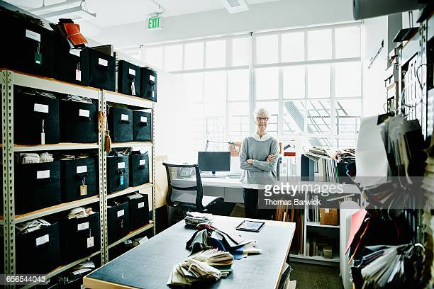 female architect in sample library in office - 女性建築家 ストックフォトと画像