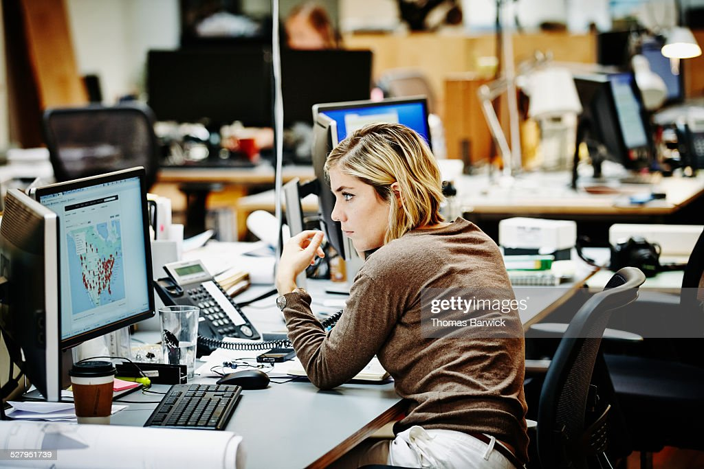 Female architect on the phone with client : Stock Photo