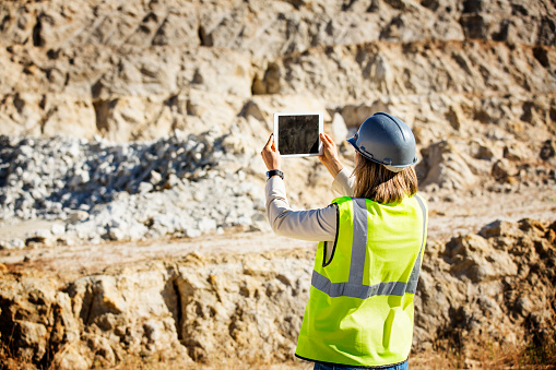 Female architect photographing quarry 551349487