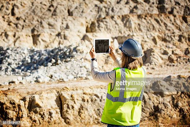 female architect photographing quarry - gruva bildbanksfoton och bilder