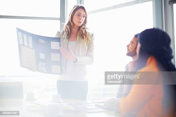 Female architect presenting samples