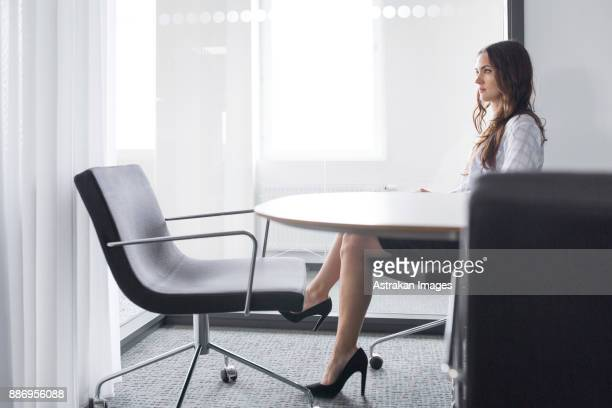 Female architect sitting at table