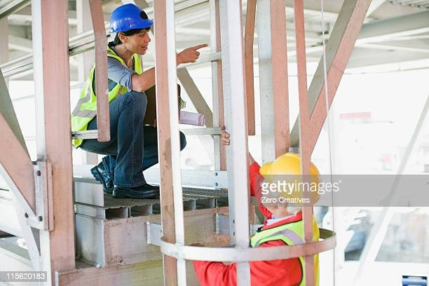 Female architect talking to a builder