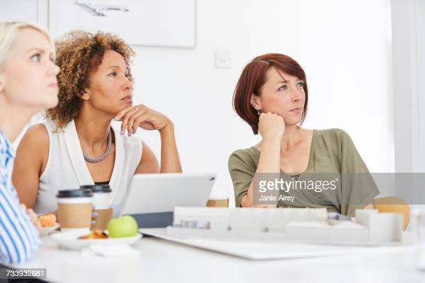 Female architect team listening during meeting