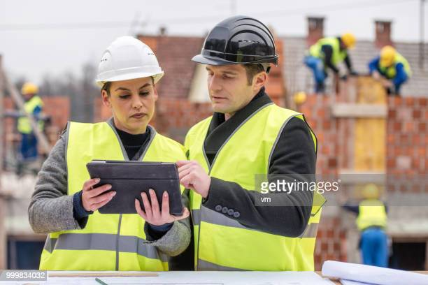 female architect with engineer - civil engineering stock pictures, royalty-free photos & images