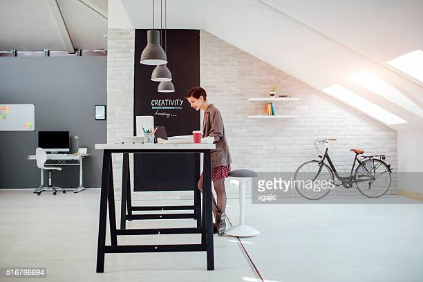 Female Architect Working In Her Office