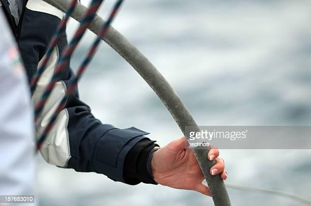 Female arm on the steering wheel