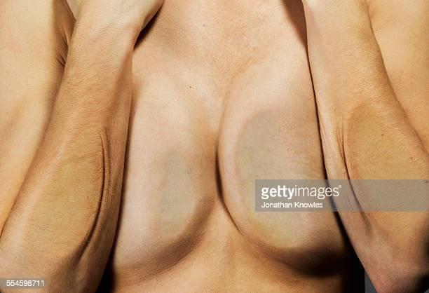 female arms and breasts pressed against glass - busen nahaufnahme stock-fotos und bilder