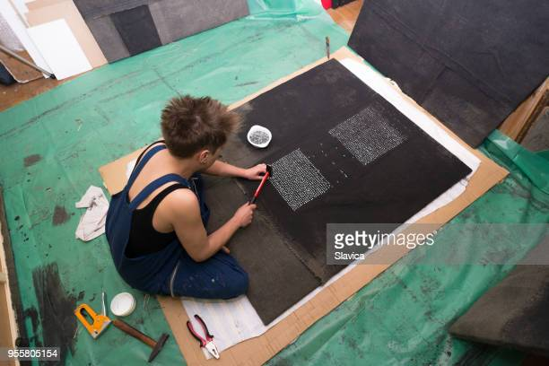 Female artist making art installation