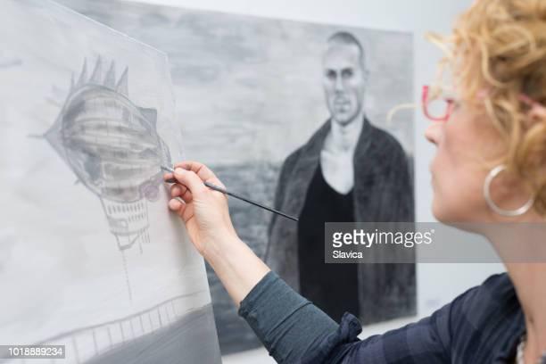 Female artist painting in the studio