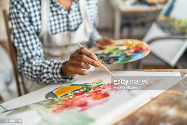 female artist working in studio - canvas stock pictures, royalty-free photos & images