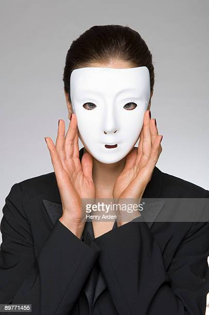 Female as business woman with mask