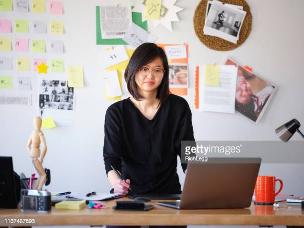 female asian design professional working from home - remote location stock pictures, royalty-free photos & images
