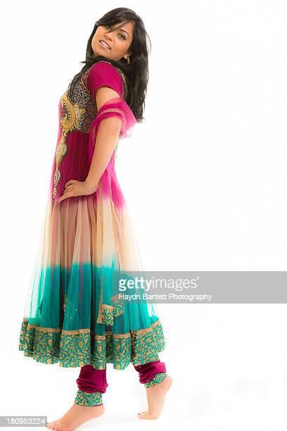 Female Asian Model full length in colourful dress