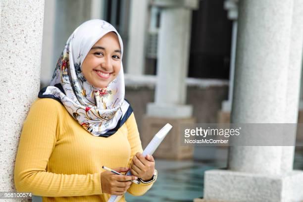 Female Asian Muslim College student portrait on campus